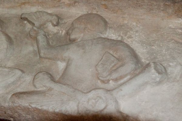 Tarrant Rushton, St Mary's Church photo, Carved figure on the marble lintel