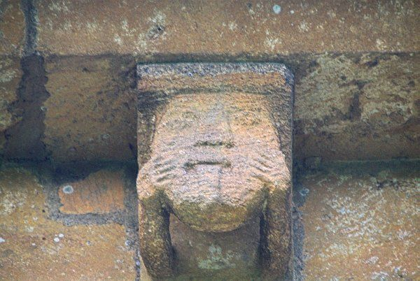 Temple Guiting, St Mary's photo, A grinning corbel head