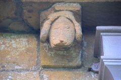 Temple Guiting, St Mary's, Corbel head of a dog