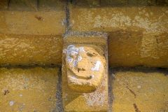 Temple Guiting, St Mary's, A smiling face corbel