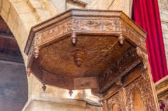 The ornately carved sounding board