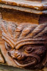 Grimacing misericord carving
