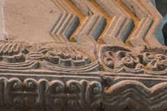 Tutbury, St Mary's Priory Church, Beautifully carved Norman string course on the west wall