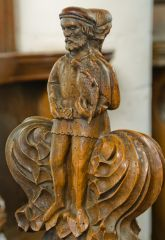 Medieval bench end carving