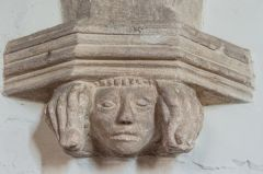 Carved corbel head, nave