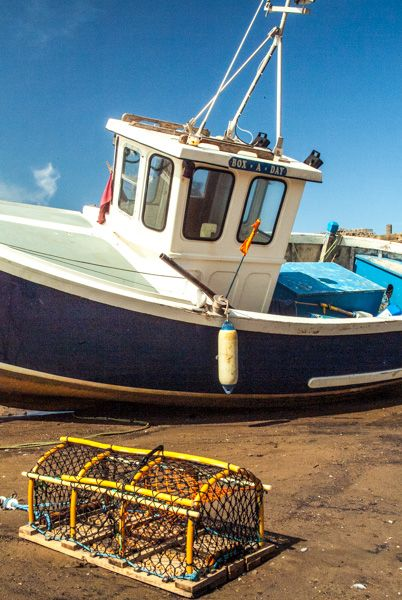 Whitby photo, A fishing boat at low tide