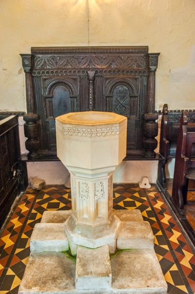 Wolford Chapel photo, The font and 17th century carved panel