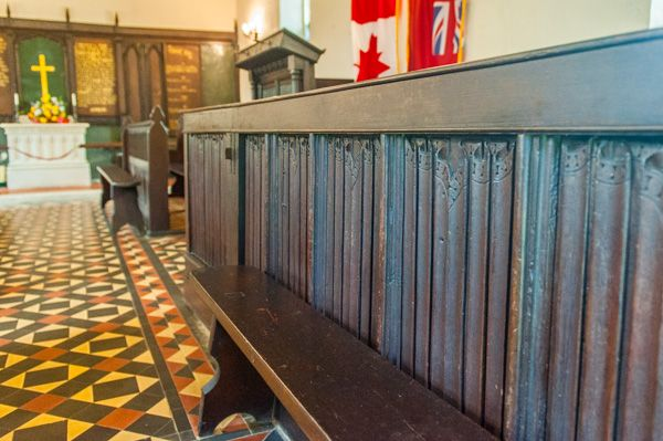 Wolford Chapel photo, 17th century linenfold panelling incorporated into a pew