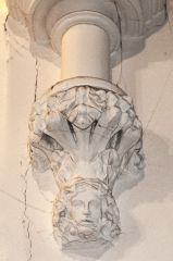 A fanciful carved corbel head