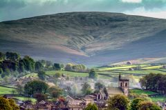 Morning mist rises over Hawes