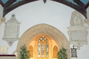 The chancel arch and wall monuments