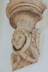 Demi-figure corbel carving