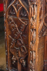 16th century carved bench end, nave