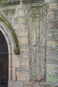 Medieval cross slab set into the exterior wall