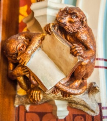 A pair of monkeys in the library