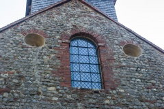 Romanesque occuli and window