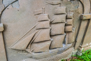Figure of a ship on a gravestone