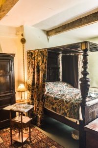 A four-poster bed in a first floor bedroom