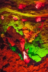 The colourfully-lit great cavern