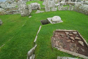 A stone hearth inside the broch