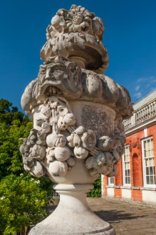 A classical urn outside the house