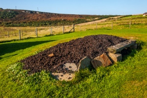 Peat drying in front of the cottage