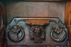 Misericord of an Angel wearing feathers