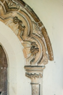South doorway, east capital and arch carving