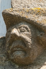 Grotesque carved head
