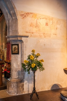 The chancel arch and wall painting