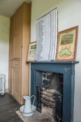 A bedroom fireplace and cupboard