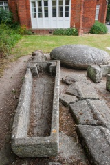 Medieval stone coffin outside the museum door