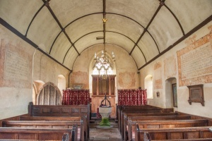 The barrel-vaulted nave and wall texts