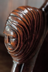 Carved bench end of a woman's head