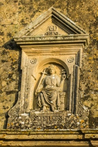 St Kenelm figure over the door