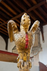 17th century pelican font cover carving