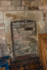 17th century blocked fireplace, chancel wall