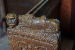 15th century lion bench end carving