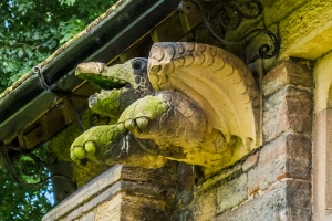 A fanciful flying turtle carving on the north wall