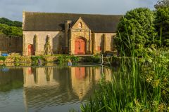 The abbey tithe barn and fish pond