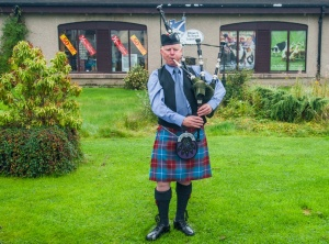 Piper at the Scottish Woollen Centre in Aberfoyle