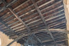 The timber roof of the arcaded market on the ground floor