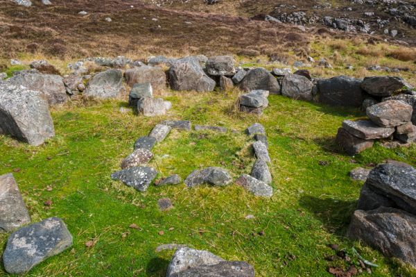 Allt Chrysal ancient settlement photo, A hearth is clearly visible inside the hut