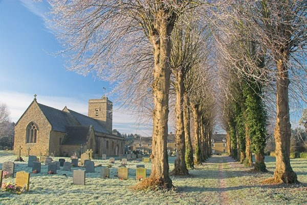 An avenue of trees leads past the parish church in Ascott under Wychwood