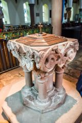 The ornately carved 13th century font