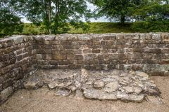A stone bench against the north west wall