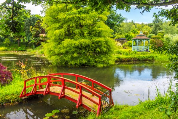 Bennetts Water Gardens photo, A footbridge and colourful gazebo on Orfe Pond