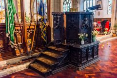 The ornately carved pulpit