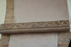Serpent carving on the chancel arch
