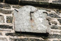 1694 sundial on the tower wall